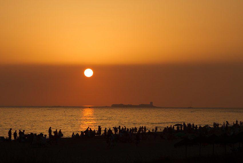 foto puesta de sol la barrosa